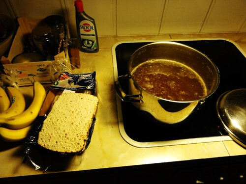 Preparation of a moose meat and bread fika.
