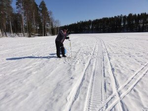 making the ice fishing hole