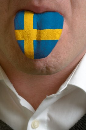 man tongue painted in sweden flag symbolizing to knowledge to sp